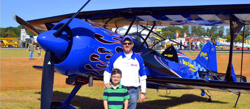 Air Show Attendees pose with Greg Connell Plane