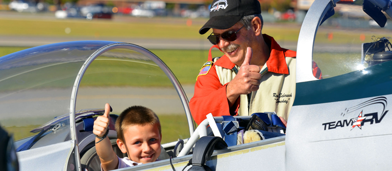 Boy Rider with Team RV gives thumbs up sign after his flight